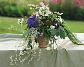 Bouquet of blue hydrangea and white Russian vine