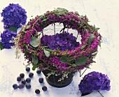 Wreath of purple loosestrife & Russian vine around hydrangea