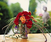 Small bouquet of begonias with roses and grasses