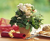 Table arrangement of white roses & wild strawberry runners