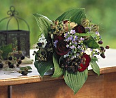 Bouquet of roses with hosta leaves, blackberries etc.