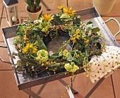 Tray with wreath of ivy, hydrangeas, Doronicum