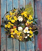 Wreath of spring flowers: narcissi, tulips, trailing ivy etc.