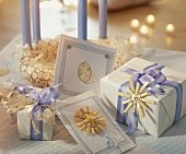 Presents and cards decorated with bows and straw stars