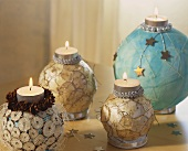 Tea lights on decorated baubles