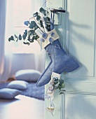 Felt boot on the door with presents & eucalyptus branches