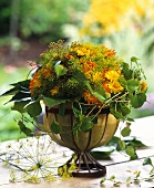 Summer bouquet of marigolds, vine tendrils, dill flowers