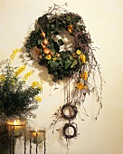 Autumn wreath of birch twigs, onions, ivy etc.