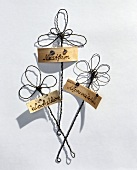 Plant labels with wire flowers