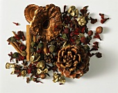 Pot-pourri with forest fruits, dried flowers, cinnamon
