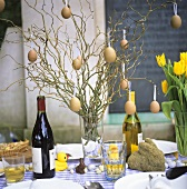A laid table decorated for Easter with wine