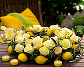 'Hollywood' rose, lemons, olive branches and pistachio leaves