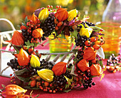 Wreath of privet berries, rose hips and Physalis