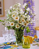 Marguerites, Campanula and Gypsophila in a glass vase