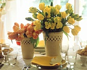 Yellow and red & yellow tulips in  yellow vase on Easter table