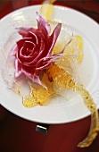 Crystallised roses on a white plate
