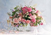 Festive bouquet of roses and meadow flowers; champagne