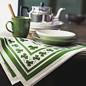 Green and white tablecloth and crockery for Irish buffet