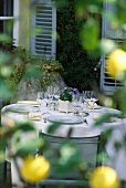 Laid table in front of French country house