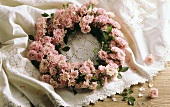 Wreath of pink roses on lace cover
