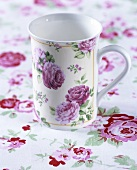 Cup with rose decoration