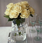 White roses in a glass jug
