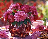Pink dahlias in vase with apple motif