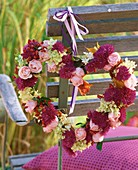 Heart-shaped wreath of roses, rose hips, asters, hydrangeas