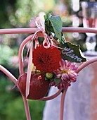 Place card (leaf), dahlias & red apple tied to chair back