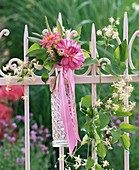 Floral decoration with dahlias on garden fence