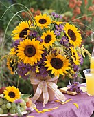 Vase of sunflowers, asters, golden rod and grasses