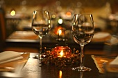 Wine glasses and lantern on laid table in restaurant