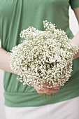 Woman holding a bunch of gypsophila