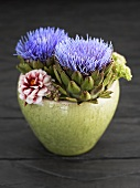 Artichoke flowers in bowl of flowers