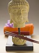 Buddha head and chopsticks