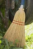 Broom beside wheelbarrow wheel
