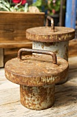 Old, rusty weights on wooden table (close-up)
