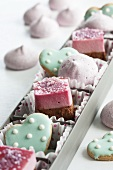 Raspberry petit fours, heart-shaped biscuits and raspberry meringues in a box