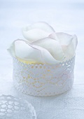 Jewellery box with white rose petals