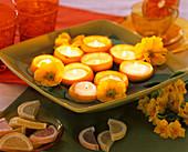 Tea lights in hollowed-out lemon halves