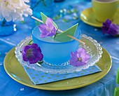 Place-setting with campanula flowers & wooden stick