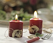 Candles with dried mushrooms tied on with string