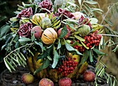 Arrangement of roses, rowan berries and fruit