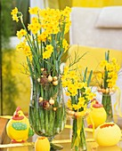 Narcissi with bilberry twigs, Easter decorations (hens & eggs)