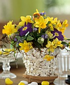 Easter arrangement of narcissi, primulas & forget-me-nots