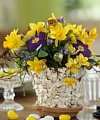 Easter arrangement of narcissi, primulas & forget-me-nots