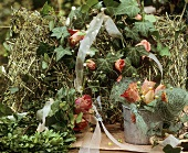 Wire basket with hay and ivy wreath