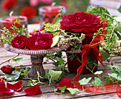 Table decorated with roses in open air