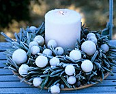 Olive wreath with white baubles and candle