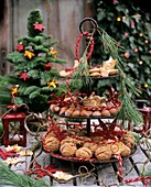 Tiered stand, decorated for Christmas, with nuts